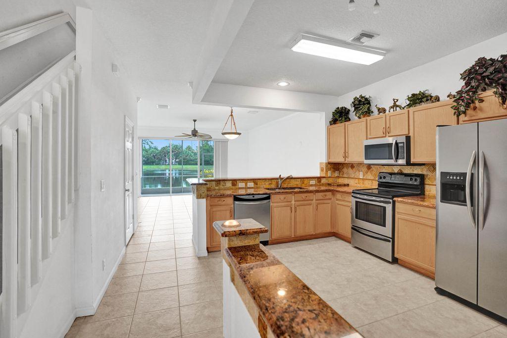 1102 Woodfield Rd, Greenacres, FL 33415